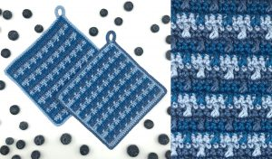 three tone blue cotton hand crocheted pot holders with blueberries