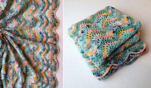 folded crochet ripple blanket in fruity colours