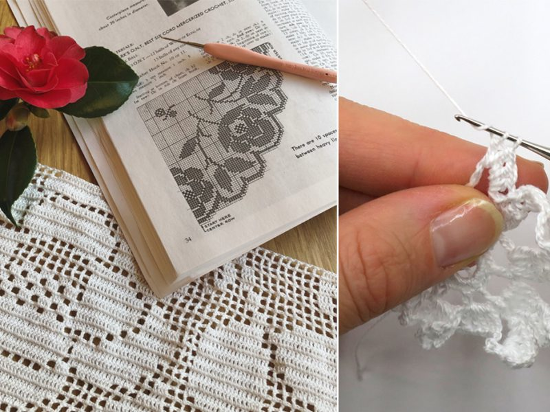 detail of filet crochet table cloth in white thread crochet with open pattern book and red camellia flower and crocheting hands
